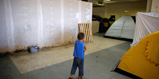 A boy makes his way inside the disused Hellenikon airport where refugees and migrants are temporarily housed in Athens, Greece July 13, 2016. REUTERS/Alkis Konstantinidis