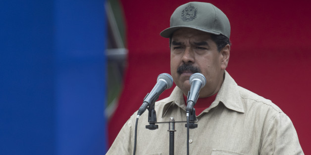 Nicolas Maduro, president of Venezuela, pauses while speaking during a ceremony with Militia members in Caracas, Venezuela, on Monday, April 17, 2017. Maduro approved a plan for Defense Minister Vladimir Padrino Lopez to expand Venezuela's voluntary militia forces to 500,000 men and equip each of them. Photographer: Carlos Becerra/Bloomberg via Getty Images