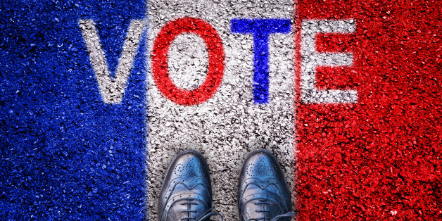 Legs and shoes on asphalt with french flag and the word 'vote'