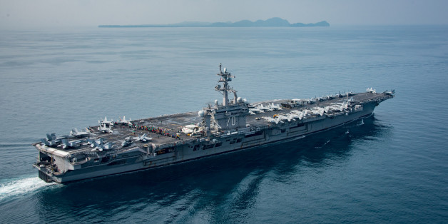 SUNDA STRAIT, INDONESIA - APRIL 14: In this handout provided by the U.S. Navy, the aircraft carrier USS Carl Vinson (CVN 70) transits the Sunda Strait on April 14, 2017 in Indonesia. The Carl Vinson Carrier Strike Group is on a scheduled western Pacific deployment as part of the U.S. Pacific Fleet-led initiative to extend the command and control functions of U.S. 3rd Fleet. U.S Navy aircraft carrier strike groups have patrolled the Indo-Asia-Pacific regularly and routinely for more than 70 years. (Photo by Mass Communication Specialist 2nd Class Sean M. Castellano / U.S. Navy via Getty Images)