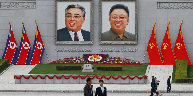 People walk in front of portraits of North Korea founder Kim Il Sung and late leader Kim Jong Il in central Pyongyang, North Korea April 16, 2017.    REUTERS/Damir Sagolj