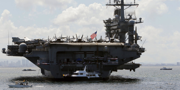 U.S. Navy's USS Carl Vinson aircraft carrier is seen anchored off the Manila bay, west of Manila May 15, 2011. The USS Carl Vinson is the ship where Osama bin Laden was given burial ritual after he was killed in a raid by U.S. Navy Seals in Abbottabad, Pakistan. The Carl Vinson is escorted by the USS Bunker Hill, the USS Shiloh guided missile cruisers and the destroyer USS Gridley which arrived in Manila on Sunday for a four-day routine port call.   REUTERS/Romeo Ranoco (PHILIPPINES - Tags: POLI