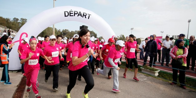 ALGIERS, ALGERIA - OCTOBER 21:  Participants, wearing pink shirts form a human ''pink ribbon'', take part in a Breast Cancer Marathon within the Breast Cancer Awareness Month events in Algiers, Algeria on October 21, 2016.  (Photo by Bechir Ramzy/Anadolu Agency/Getty Images)