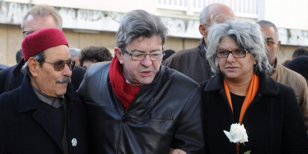 The widow of murdered Tunisian opposition figure Chokri Belaid, Basma Khalfaoui (R), his father Salah Belaid (L) and French left wing party Front de Gauche (FG) leader Jean-Luc Melenchon (C), attend a ceremony marking the second anniversary of his death, on February 6, 2015 in the capital Tunis. Belaid, an anti-Islamist politician, was shot dead by suspected jihadists two years ago. AFP PHOTO / SALAH HABIBI        (Photo credit should read SALAH HABIBI/AFP/Getty Images)