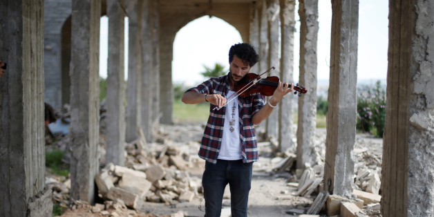 Ameen Mukdad, a violinist from Mosul who lived under ISIS's rule for two and a half years where they destroyed his musical instruments, performs at Nabi Yunus shrine in eastern Mosul, Iraq, April 19, 2017. REUTERS/ Muhammad Hamed