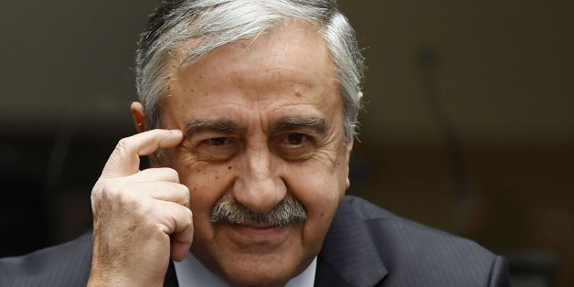 Turkish Cypriot leader Mustafa Akinci gestures during a press conference on UN-sponsored Cyprus peace talks on January 13, 2017 at the Unites Nations headquarters in Geneva. Hopes for a peace deal in Cyprus stalled on January 13, 2017 over a decades-old dispute, with the rival sides at loggerheads over the future of Turkish troops on the divided island. A week of UN-brokered talks in Geneva between Greek Cypriot President and Turkish Cypriot leader sparked optimism that an agreement to reunify the island could be at hand. But any settlement will require an agreement on Cyprus's future security, with key players Greece, Turkey and former colonial power Britain needing to sign on.    / AFP / PHILIPPE DESMAZES        (Photo credit should read PHILIPPE DESMAZES/AFP/Getty Images)