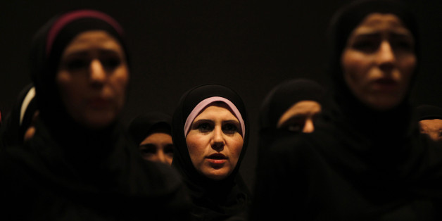 "Syrian refugee women perform the play ""The Syria Trojan Women"" in Amman December 18, 2013. Syrian actress Nanda Mohammad trained Syrian refugee women for six weeks to reinterpret ""The Trojan Women"",  a tragedy by Greek playwright Euripides on the Greeks' treatment of Trojan women after the fall of Troy. ""The Syria Trojan Women"" traces the parallels between the fates of the women of Troy and Syrian women refugees fleeing the violence in their country. REUTERS/Muhammad Hamed (JORDAN - Tags: CONFLI"