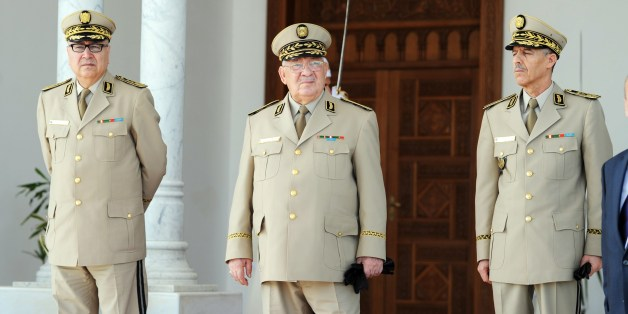 Algeria's Chief of Staff General Ahmed Gaid Salah (C) is seen during the arrival of French Defence Minister Jean-Yves Le Drian at the Houari-Boumediene International Airport in Algiers, on May 20, 2014. Drian in on a 24-hour official visit to the north African country. AFP PHOTO/FAROUK BATICHE        (Photo credit should read FAROUK BATICHE/AFP/Getty Images)