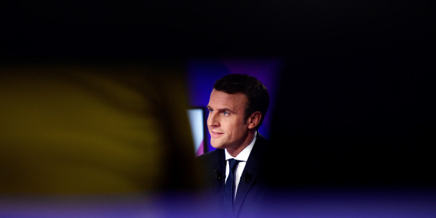 "Emmanuel Macron, head of the political movement En Marche!, or Onwards!, and candidate for French 2017 presidential election, attends the France 2 television special prime time political show, ""15min to Convince"" in Saint-Cloud, near Paris, France, April 20, 2017.  REUTERS/Martin Bureau/Pool"
