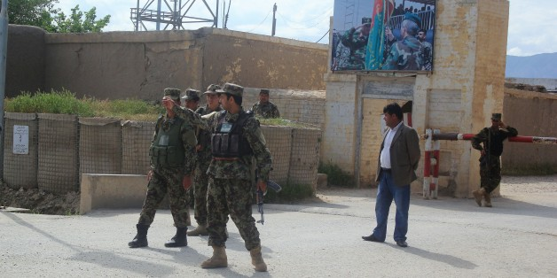 BALKH, AFGHANISTAN - APRIL 22: Afghan security officials are seen after ambulances carry people, who got wounded on Taliban fighters' attack to the 209th Corps, to hospitals in Balkh province, Afghanistan on April 22, 2017. (Photo by Sayed Khodaberdi Sadat/Anadolu Agency/Getty Images)