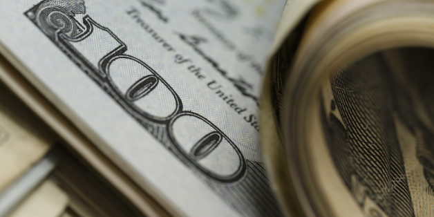 Closeup of curled and flat $100 bills ; shot with very shallow depth of field