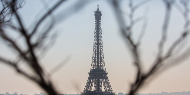 The Eiffel Tower stands as residential and commercial properties sit on the city skyline in Paris, France, on Friday, April 21, 2017. The murder of a policeman on the Champs-Elysees has forced an early end to campaigning for the leading candidates in France's presidential election as they head into Sundays first-round of voting with the race wide open. Photographer: Christophe Morin/Bloomberg via Getty Images