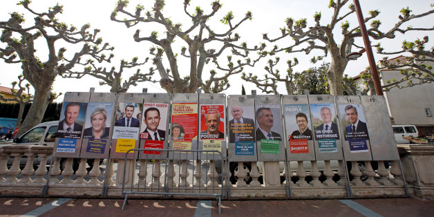 "Campaign posters of the 11 candidates who run in the 2017 French presidential election are seen in Le Soler, near Perpignan, France April 15, 2017. (L-R) Debout La France group candidate Nicolas Dupont-Aignan, French National Front (FN) political party leader Marine Le Pen, head of the political movement En Marche! (Onwards!) Emmanuel Macron, French Socialist party candidate Benoit Hamon, France's extreme-left Lutte Ouvriere political party (LO) leader Nathalie Arthaud, Anti-Capitalist Party (NPA) presidential candidate Philippe Poutou, ""Solidarite et Progres"" (Solidarity and Progress) party candidate Jacques Cheminade, lawmaker and independent candidate Jean Lassalle, candidate of the French far-left Parti de Gauche Jean-Luc Melenchon, UPR candidate Francois Asselineau and the Republicans political party candidate Francois Fillon. REUTERS/Jean-Paul Pelissier"