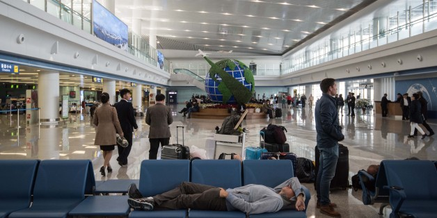 Travellers wait at Pyongyang airport on April 17, 2017.Tourists and foreign journalists, who attended the huge military parade on April 15 during which North Korea showcased apparent intercontinental ballistic missiles, were left waiting at Pyongyang airport as flights were delayed. / AFP PHOTO / ED JONES        (Photo credit should read ED JONES/AFP/Getty Images)