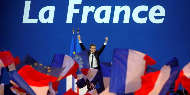 Emmanuel Macron, head of the political movement En Marche !, or Onwards !, and candidate for the 2017 French presidential election, celebrates on stage at the Parc des Expositions hall in Paris after partial results in the first round of 2017 French presidential election, France, April 23, 2017.   REUTERS/Philippe Wojazer     TPX IMAGES OF THE DAY