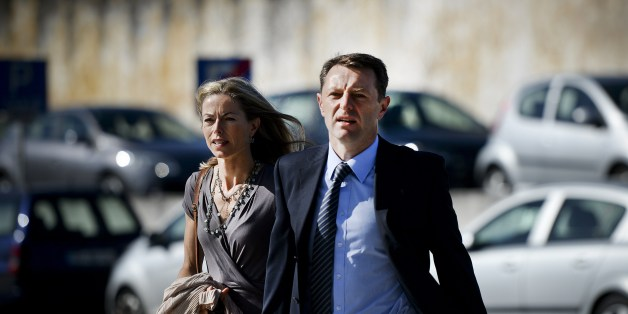 Britons Kate McCann (L) and her husband Gerry McCann (C), parents of missing British girl Madeleine McCann, arrive to the court house in Lisbon on June 16, 2014 for the closing arguments of the McCann couple's libel proceedings against former inspector Goncalo Amaral for a book written about the case of their missing daughter. Kate McCann and her husband Gerry are suing Amaral in a Lisbon court for the book in which he argues Madeleine was killed accidentally and implicates her parents in her al