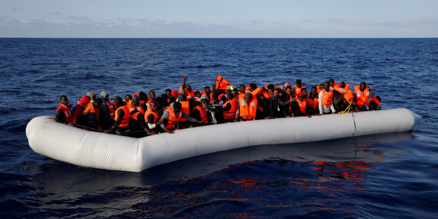 Migrants in a dinghy await rescue by the Migrant Offshore Aid Station (MOAS) around 20 nautical miles off the coast of Libya, June 23, 2016.  Picture taken June 23, 2016. REUTERS/Darrin Zammit Lupi MALTA OUT. NO COMMERCIAL OR EDITORIAL SALES IN MALTA