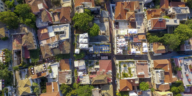 ATHENS, GREECE - MAY 27: Aerial view of Anafiotika on May 27, 2016 in Athens, Greece. Anafiotika is a scenic tiny neighborhood of Athens, part of old historical neighborhood called Plaka. It lies in northerneast side of the Acropolis hill. First houses were built in the era of Otto of Greece when workers from the island of Anafi came to Athens in order to work as constructor workers in the refurbishment of King Othon's Palace.The first two inhabitants were G. Damigos, carpenter and M. Sigalas, c