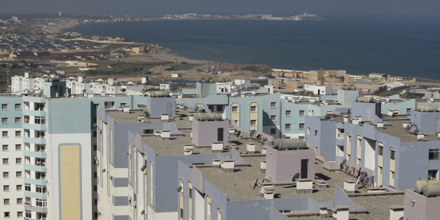 A general view shows newly constructed residential buildings in Ain Benian on the outskirts of the Algerian capital Algiers, July 8, 2013. Political and social pressures are combining to open Algeria's construction market to international competition, potentially making billion of dollars worth of contracts available to foreign companies. Housing supply has long been a source of public discontent in Algeria, which has a young and growing population of 37 million. Migration to the cities has packed some extended families into tiny apartments or forced them to live in shacks. Picture taken July 8, 2013. REUTERS/Ramzi Boudina (ALGERIA - Tags: REAL ESTATE BUSINESS)