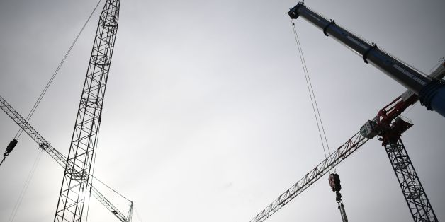 Cranes are pictured at the metro construction site on March 21, 2017 in the French western city of Rennes. / AFP PHOTO / DAMIEN MEYER        (Photo credit should read DAMIEN MEYER/AFP/Getty Images)