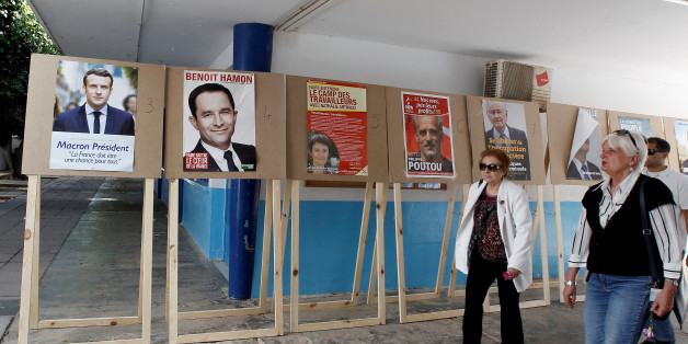 French citizens, who reside in Tunisia, arrive to cast their votes for French presidential election, at a polling station in Tunis, Tunisia April 23, 2017. REUTERS/Zoubeir Souissi