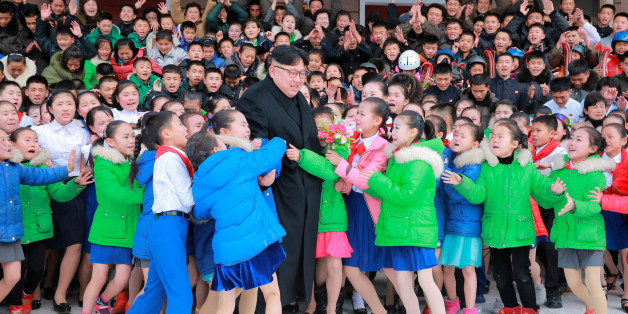 North Korean leader Kim Jong Un is hugged by children during his visit to Samjiyon County in this undated photo released by North Korea's Korean Central News Agency (KCNA) in Pyongyang November 28, 2016. REUTERS/KCNA   ATTENTION EDITORS - THIS IMAGE WAS PROVIDED BY A THIRD PARTY. EDITORIAL USE ONLY. REUTERS IS UNABLE TO INDEPENDENTLY VERIFY THIS IMAGE. NO THIRD PARTY SALES. NOT FOR USE BY REUTERS THIRD PARTY DISTRIBUTORS. SOUTH KOREA OUT. NO COMMERCIAL OR EDITORIAL SALES IN SOUTH KOREA.       TP