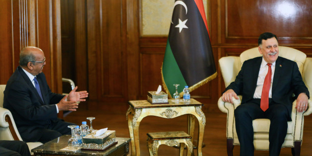 Algeria's Minister Delegate for Maghreb and African Affairs, Abdelkader Messahel (L), meets with with Libyan Prime Minister Fayez al-Sarraj in the capital Tripoli on April 21, 2017. / AFP PHOTO / MAHMUD TURKIA        (Photo credit should read MAHMUD TURKIA/AFP/Getty Images)