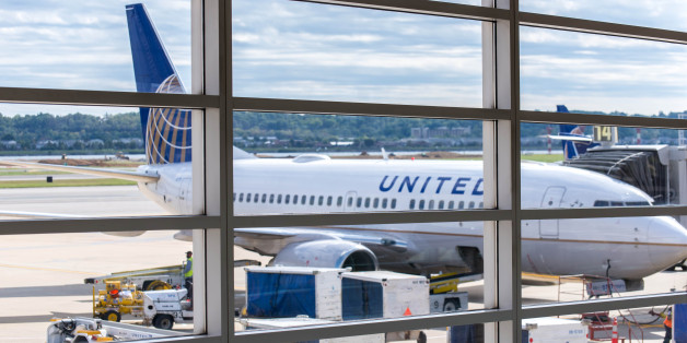 Washington, DC, United States - October 4, 2014: DCA, Reagan National Airport, Washington, DC - View out airport window to airplanes and ramp operations