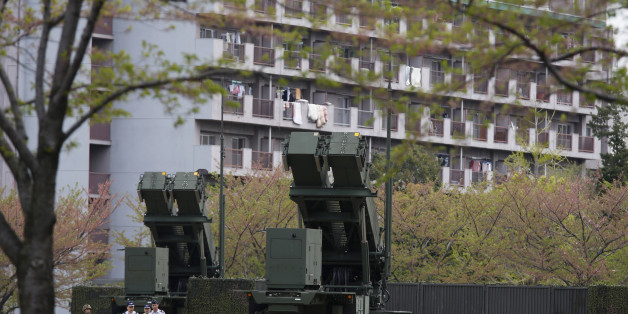 Units of Patriot Advanced Capability-3 (PAC-3) missiles stand in front of a housing complex, at the Defence Ministry in Tokyo April 9, 2013. Japanese public broadcaster NHK showed aerial footage of what it said were ballistic missile interceptors being deployed near Tokyo in response to North Korea's threats and actions. Japan in the past has deployed ground-based PAC-3 interceptors, as well as Aegis radar-equipped destroyers carrying Standard Missile-3 (SM-3) interceptors in the run-up to North Korean missile launches. REUTERS/Issei Kato (JAPAN - Tags: POLITICS MILITARY)