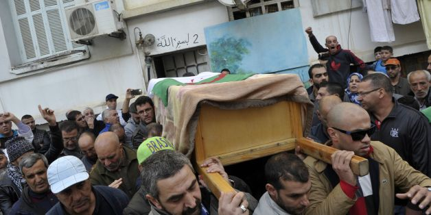 Relatives and friends leave the family house carrying the body of British-Algerian journalist Mohamed Tamalt before going to the cemetery during his funeral, on December 12, 2016 in Algiers.Mohamed Tamalt died on December 11, 2016 after having staged a hunger strike to protest a two-year jail term for offending Algeria's president in a poem posted online, his lawyer said. / AFP / RYAD KRAMDI        (Photo credit should read RYAD KRAMDI/AFP/Getty Images)