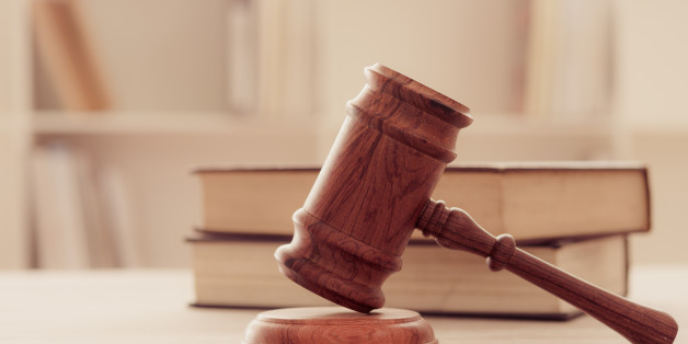 Closeup wooden judges gavel on wooden table with legal books. retro style. soft focus.