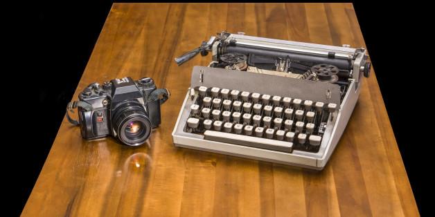 Old typewriter on a wooden desk