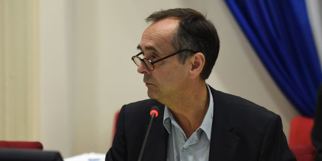 Beziers' mayor Robert Menard leads a municipal council in Beziers, southern France, on October 18, 2016, during which a local referendum on the welcoming of migrants to the city was planned to take place at the end of the meeting.