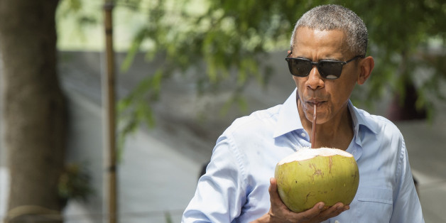 US President Barack Obama drinks from a coconut as he makes a surprise stop for a drink alonside the Mekong River in Luang Prabang on September 7, 2016.Obama became the first US president to visit Laos in office, touching down in Vientiane late on September 5 for a summit of East and South East Asian leaders. / AFP / SAUL LOEB        (Photo credit should read SAUL LOEB/AFP/Getty Images)