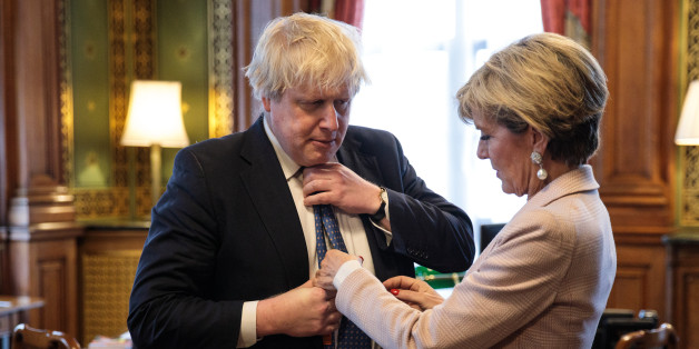 LONDON, ENGLAND - FEBRUARY 23: British Foreign Secretary Boris Johnson has his tie straightened by his Australian counterpart Foreign Minister Julie Bishop in his office at the Foreign and Commonwealth Office in Westminster on February 23, 2017 in London, England. Mr Johnson meets with Ms Bishop for the second time since he was promoted to Foreign Secretary in Prime Minister Theresa May's post- Brexit cabinet. Mr Johnson has been keen to commend the U.K.- Australia close friendship and sees the