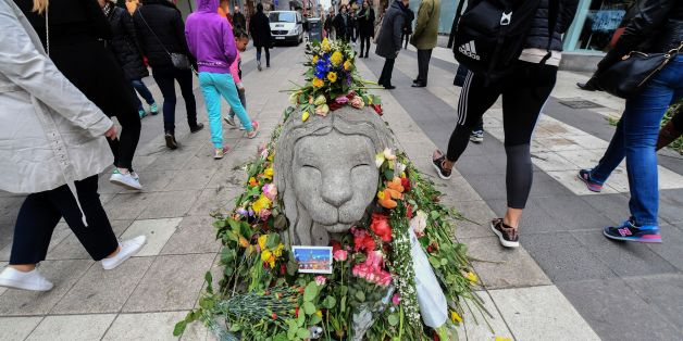 People walk by flowers near Ahlens department store at the pedestrian  street Drottninggatan in central Stockholm on April 12, 2017, five days after a hijacked beer truck plowed into pedestrians there killing four people, injuring 15 others.                / AFP PHOTO / TT News Agency / Fredrik SANDBERG / Sweden OUT        (Photo credit should read FREDRIK SANDBERG/AFP/Getty Images)