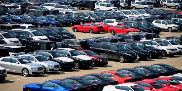 Imported cars are seen parked at a parking lot near a port in Qingdao, east China's Shandong province on April 17, 2017.Global carmakers converge on China for the Shanghai auto show this week, with the industry bracing for a sharp sales slowdown and potential price war as competition stiffens in the world's biggest car market. / AFP PHOTO / STR / China OUT        (Photo credit should read STR/AFP/Getty Images)
