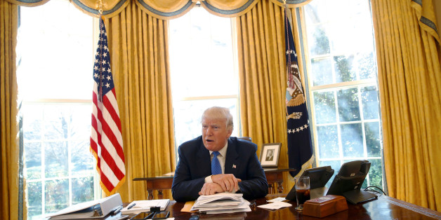 U.S. President Donald Trump gives an interview from his desk in the Oval Office at the White House in Washington, U.S., February 23, 2017. REUTERS/Jonathan Ernst     TPX IMAGES OF THE DAY