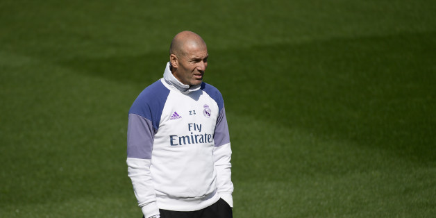 Real Madrid's French coach Zinedine Zidane attends a training session at Valdebebas Sport City in Madrid on April 28, 2017 on the eve of their Liga football match against Valencia. / AFP PHOTO / PIERRE-PHILIPPE MARCOU        (Photo credit should read PIERRE-PHILIPPE MARCOU/AFP/Getty Images)