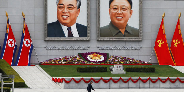 A man walks in front of portraits of North Korea founder Kim Il Sung and late leader Kim Jong Il in central Pyongyang, North Korea April 16, 2017.    REUTERS/Damir Sagolj     TPX IMAGES OF THE DAY