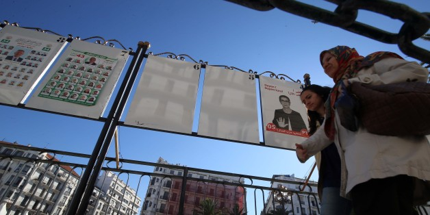 Women walk by electoral campaign posters for the upcoming legislative elections in Algiers centers, Algeria, on April 12 , 2017. (Photo by Billal Bensalem/NurPhoto via Getty Images)