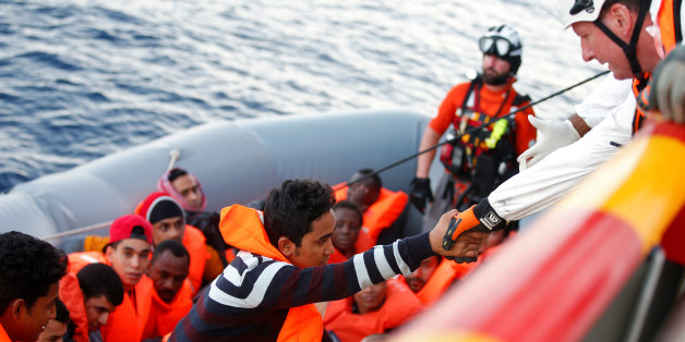 Migrants are seen during rescue operation in the Mediterranea Sea October 20, 2016. Yara Nardi/Italian Red Cross press office/Handout via Reuters ATTENTION EDITORS - THIS IMAGE WAS PROVIDED BY A THIRD PARTY. EDITORIAL USE ONLY.