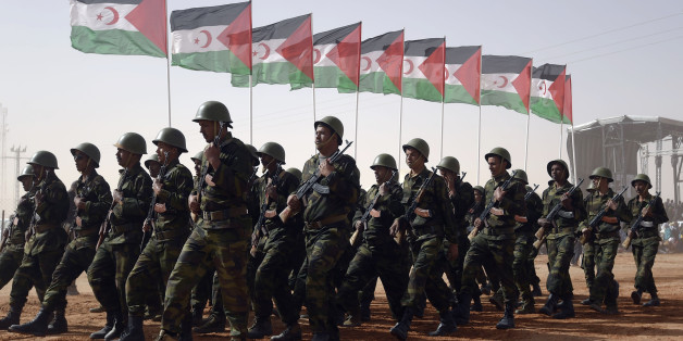 Members of the Sahrawi People's Liberation Army parade with Polisario Front's flags during a ceremony to mark 40 years after the Front proclaimed the Sahrawi Arab Democratic Republic (SADR) in the disputed territory of Western Sahara on February 27, 2016 at the Sahrawi refugee camp of Dakhla which lies 170 km to the southeast of the Algerian city of Tindouf. SADR was declared in 1976 by the Polisario Front -- a rebel movement that wants independence for Western Sahara -- which fought a guerrilla
