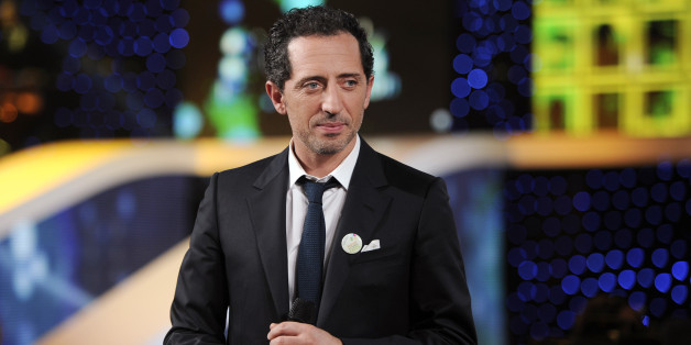 French actor Gad Elmaleh attends the 25th Telethon organised by the French Muscular Dystrophy Association (AFM) in Saint Denis, near Paris December 3, 2011. The annual fundraising event, which is aired live on French television for 30 hours, is held to collect money for research into genetic diseases in children. REUTERS/Gonzalo Fuentes (FRANCE - Tags: ENTERTAINMENT HEALTH)
