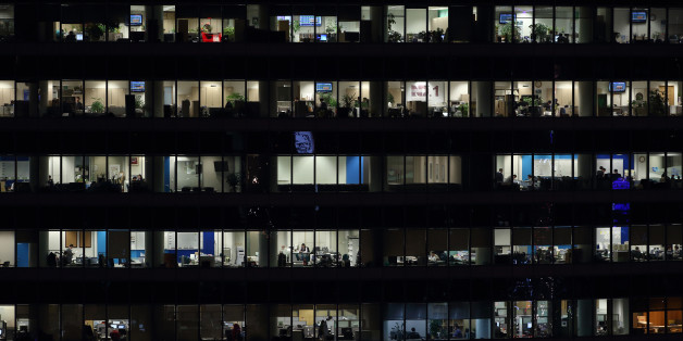 Offices in a building sit illuminated at night in the Gangnam district in Seoul, South Korea, on Monday, Dec. 2, 2013. South Korea's economy will grow 3.9 percent next year - the fastest pace since 2010 - after a 2.8 percent expansion in 2013, the finance ministry projected in September. Photographer: SeongJoon Cho/Bloomberg via Getty Images