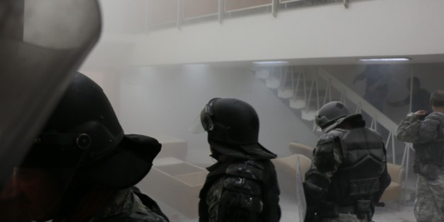 SKOPJE, MACEDONIA - APRIL 27: Police use tear gas to the protesters demonstrate inside the parliament as a session held to vote electing a parliament speaker canceled due to ongoing tension following a brawl between MPs at Macedonian Parliament in Skopje, Macedonia on April 27, 2017. People those entered the parliament from outside intervene in the MPs. (Photo by Besar Ademi/Anadolu Agency/Getty Images)