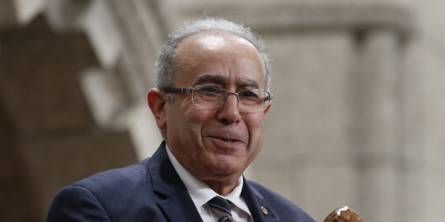 Algeria's Foreign Minister Ramtane Lamamra reacts while being recognized by the Speaker in the House of Commons on Parliament Hill in Ottawa September 29, 2014. REUTERS/Chris Wattie (CANADA - Tags: POLITICS)