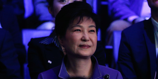 South Korea's president Park Geun-Hye (L) attends a K-Pop concert, the KCON 2016, at the Bercy Arena, in Paris, on June 2, 2016. / AFP / POOL / Thibault Camus        (Photo credit should read THIBAULT CAMUS/AFP/Getty Images)
