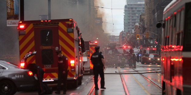 Police and emergency crews at the scene of a fire investigation of an underground explosion in the financial district in downtown Toronto, Ontario, Canada May 1, 2017. REUTERS/Chris Helgren