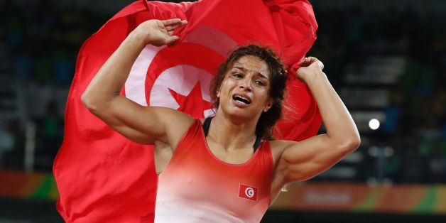 Tunisia's Marwa Amri celebrates after winning against Azerbaijan's Yuliya Ratkevich in their women's 58kg freestyle bronze medal match on August 17, 2016, during the wrestling event of the Rio 2016 Olympic Games at the Carioca Arena 2 in Rio de Janeiro.  / AFP / Jack GUEZ        (Photo credit should read JACK GUEZ/AFP/Getty Images)